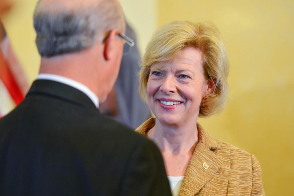 Senator Tammy Baldwin shaking supporter's hand.